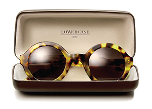 acb81a28e0fc A sun frame and accompanying case from the Lowercase eyewear line.